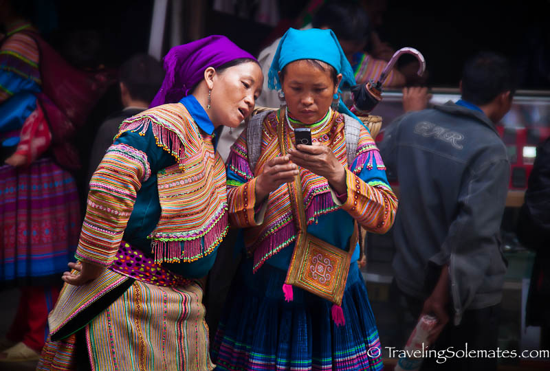 18_Flower Hmong women on cellphone, Bac Ha Market, Vietnam